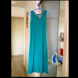 Sexy ripped-back turquoise maxi