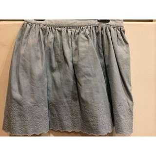 Light Wash Denim Skirt With Detailing At The Bottom