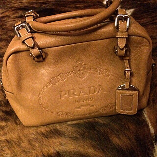 f3f4acebfaf9 Prada Pebbled Leather Bag With Embossed Logo   Silver
