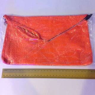 Brand New Orange Clutch Bag