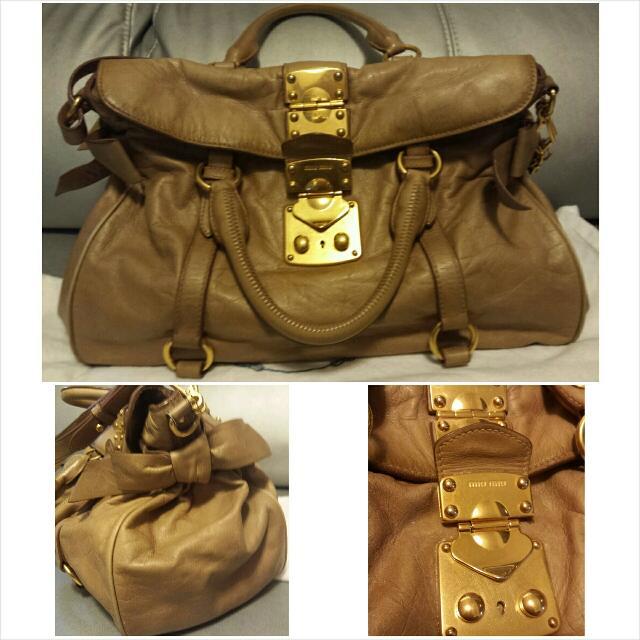 b7404533e83b Miu Miu Apricot Bow Embellished Glossed Leather Slouchy Totes ...