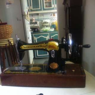 Sewing Machine Hand Operated On A Table Top Made In Shanghai
