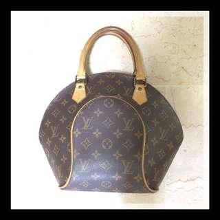Authentic Louis Vuitton LV Clam shaped handbag