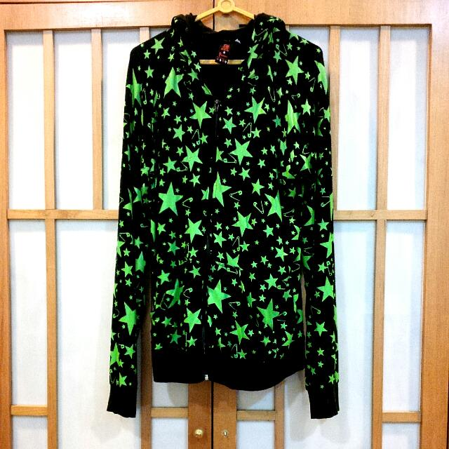 black hoodie with green stars. skinny fit estimated size S
