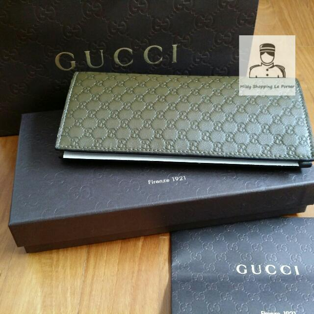 083155d332f5 Gucci Signature monogram embossed leather Flip Wallet, Luxury on Carousell