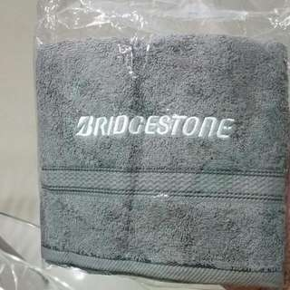100% Authentic NEW in Plastic BRIDGESTONE gym Workout Towel.