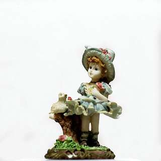 Farm Girl With Duck Statue