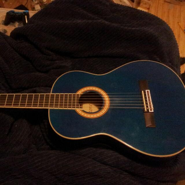 BLUE CLASSICAL GUITAR TUNED AND READY TO PLAY WITH CASE! ONLY $80!!