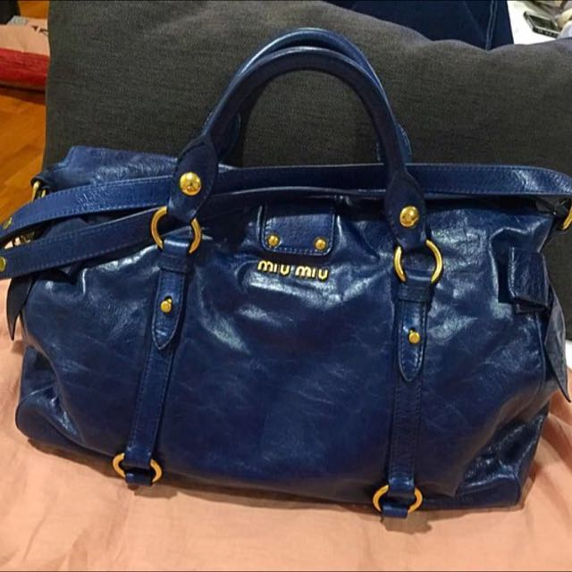 Pre Loved Miu Miu Navy Blue Distressed Glazed Butterfly Bow Bag with  Signature Buckle 0037c5a10d05d
