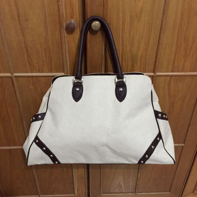 米色亮面咖啡提把小型行李袋