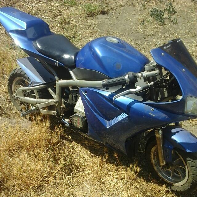 RX7mini pocket Bike (Blue) W/serial number(vehicle ID Number) W/keys To Start It.