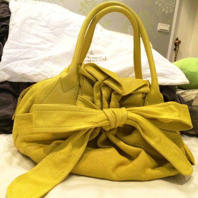 Vivienne Westwood 真皮蝴蝶結黃色手提包
