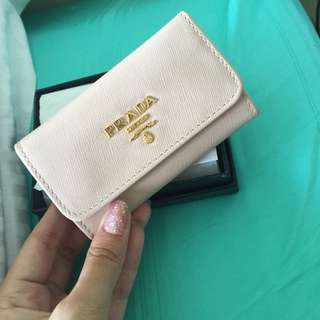 Creme prada Key holder.