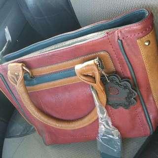 Gussaci Handbag