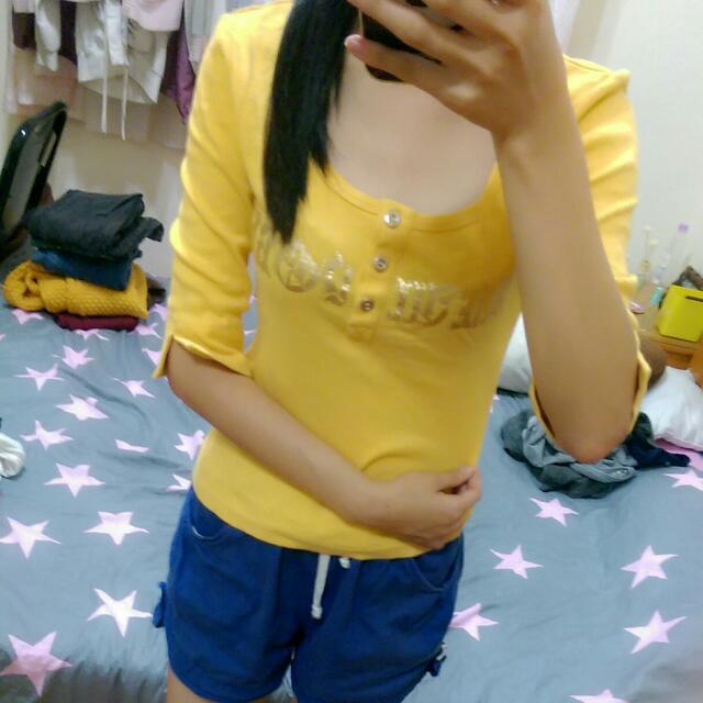 亮黃色五分袖衣