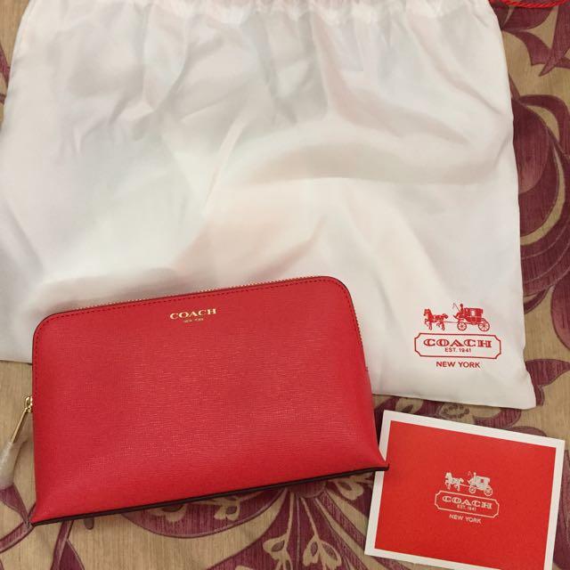 Coach桔紅色化妝包、隨身收納包(已下訂保留)