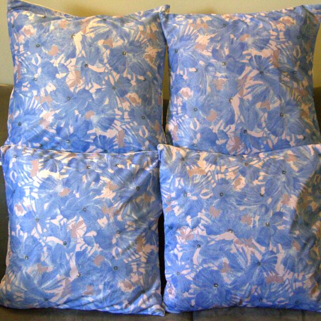 A Set of four Blue floral cushion covers