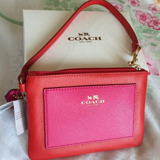 (保留中)Coach F53142 紅色桃紅前置袋手拿中夾 時髦款