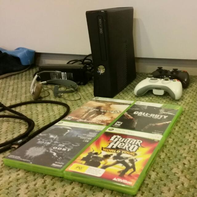 XBOX 360 SLIM (250GB) + 4 Games + 2 Controllers & More!
