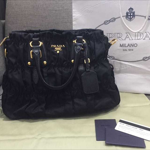 dd115f2b1a6767 Authentic And Very Good Condition Prada BN1336 Tessuto Gaufre In Black Nylon  and Calfskin trim and GHW, Luxury on Carousell