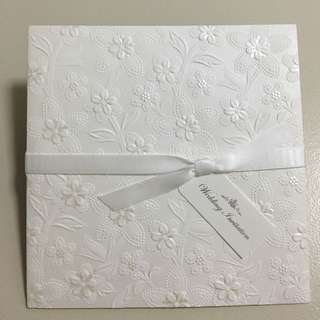 White Floral Embossed Wedding Card With Ribbon