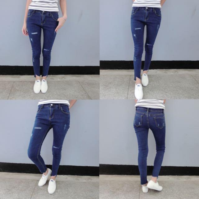 不規則褲腳微刷破顯瘦牛仔褲