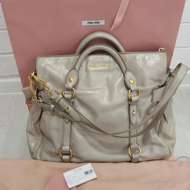 0e8301d87d06 Almost BRAND New MIU MIU vitello Lux Bow Bag In Pomice