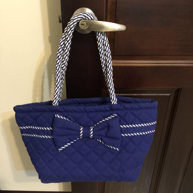 蝴蝶結藍色包包