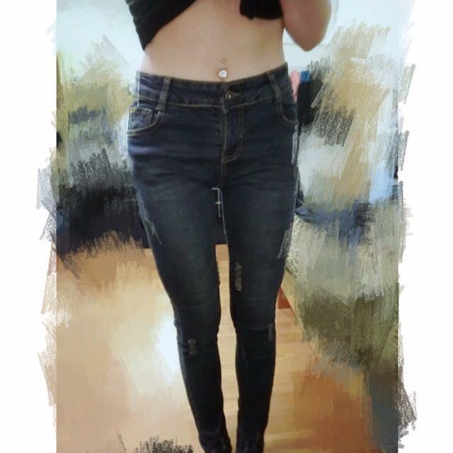 小刷毛牛仔褲。新