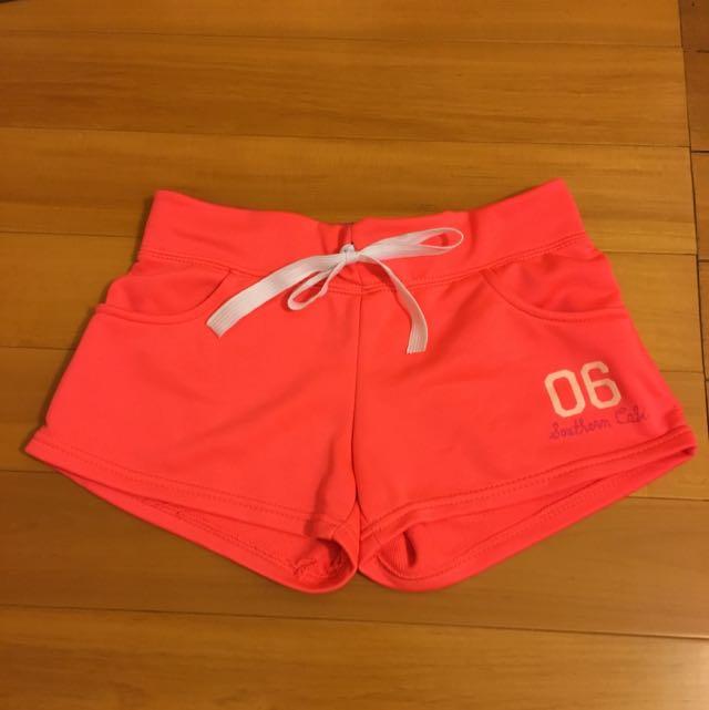 螢光橘紅小熱褲