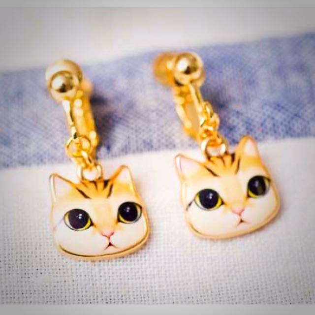 韓國帶回黃色大眼貓夾式耳環。全新