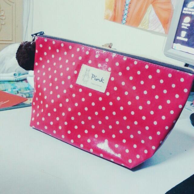 粉色點點萬用包