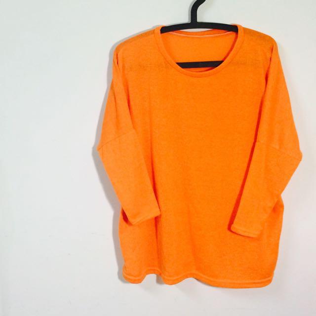 亮橘針織衣
