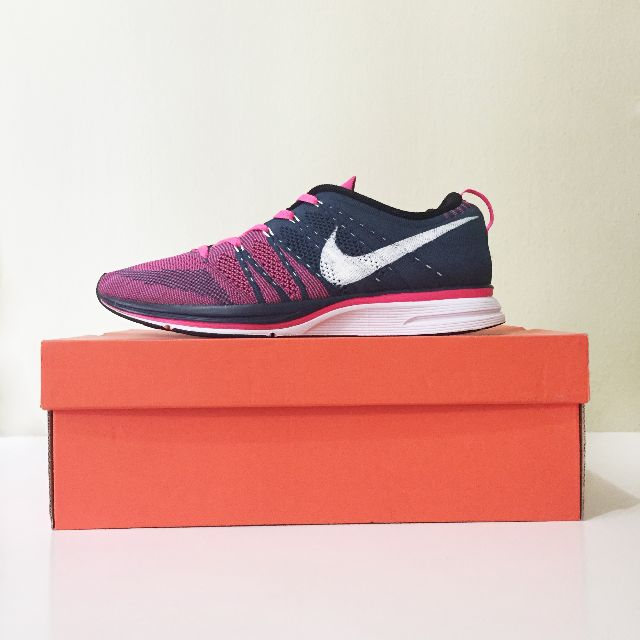 389904a902420 Nike Flyknit Trainer Squadron Blue Flash Pink Size 9.5