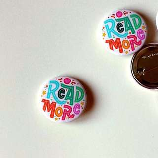 Read More pin for Book AID. Hand type button. Proceeds will go to Book AID