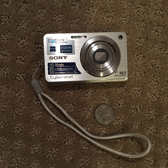 Sony Cyber-Shot 14.1 Mega Pixels. Great Condition. Bought For A Vacation Then Never Used It Again. Comes With Case, Charger And USB/ Audio Cables As Shown In The Picture.