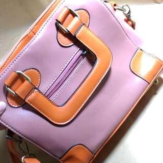 囧包 粉色加橘色 很特別 全新未使用可手提可側背喔