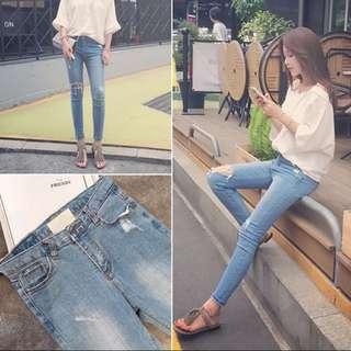 淺藍刷破牛仔褲