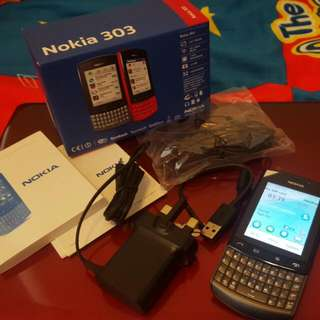RESERVED (Touch & Type) Nokia Asha 303