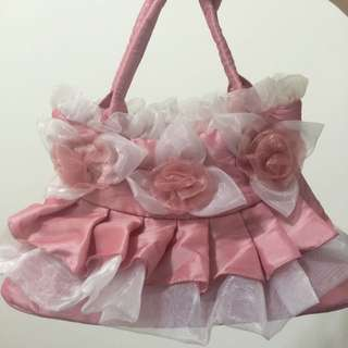 粉色花朵手提包