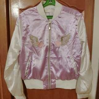 Mussa外套。八成新。有點類似緞面的質料 少穿