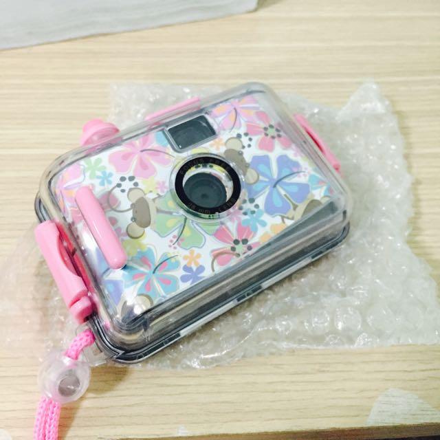 粉紅色底片相機花花圖案