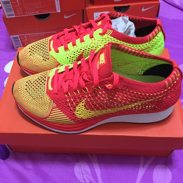 bf0440a99736 Nike Flyknit Racer Bright Crimson Volt