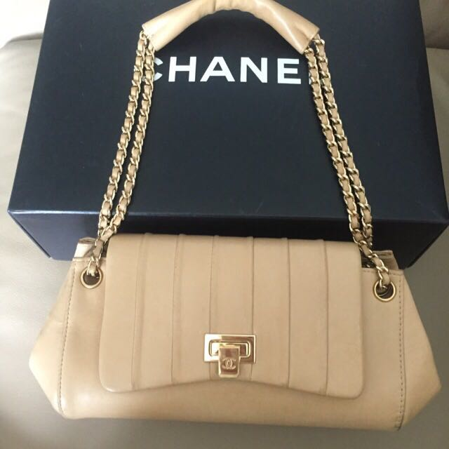 e59ed8f4dd96 CHANEL Mademoiselle Accordion Flap In Dark Beige Lambskin And Shiny Gold  HW, Luxury on Carousell