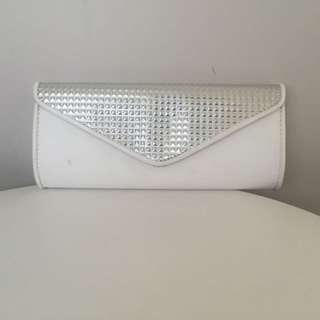 White and silver clutch