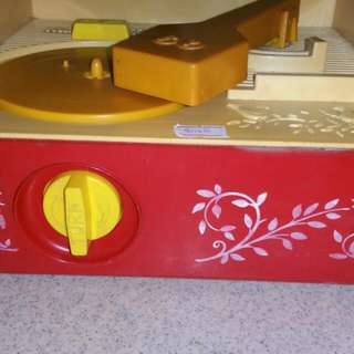 60s Fisher Price Turntable for Children. Come With 5 Nos Of Children song In A Form Of Round Plastic Vinyl