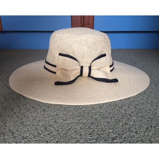 Straw hat with bow and black trimmings