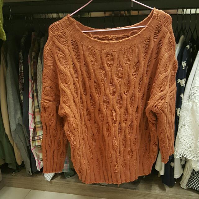橘色針織衣