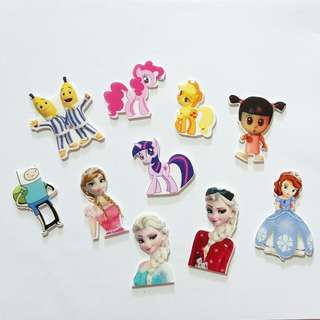 Assorted Cartoon Brooches (Banana In Pyjamas / Frozen Elsa & Anna, Little Pony, Monster Inc)