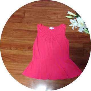 Coral Cut Out Peplum Top